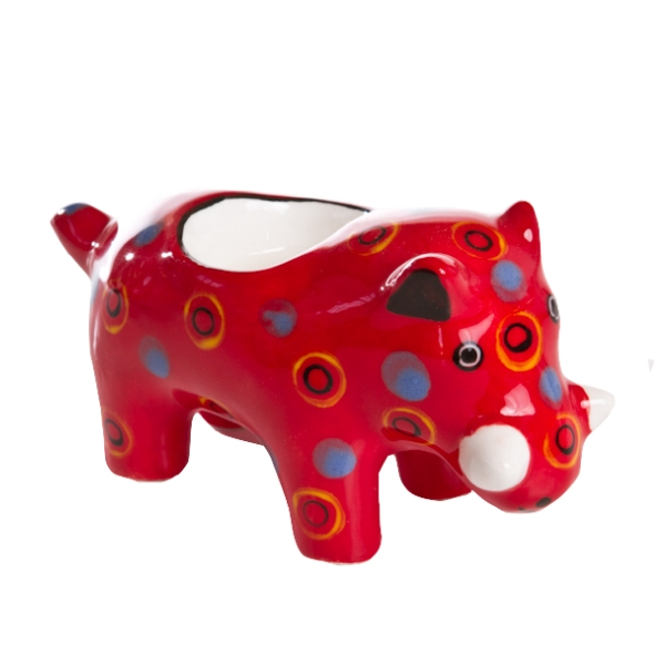 Handmade ceramic warthog tealight holder slipcast from clay and painted with vibrant patterns and colours